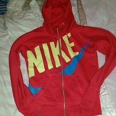 Red, Scuba Nike zip up Warm, zip up with high scuba zipper (comes up to the chin when all the way zipped but not tight at all). Red lettering with blue logo. Bought over 5 years ago so you cant find it any more, yet great great perfect condition. Nike Tops Sweatshirts & Hoodies