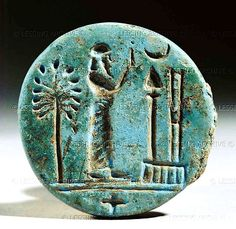 A priest in prayer before the symbols for Marduk, chief god of Babylon, and Nabu, god of wisdom and writing. Neo-Babylonian, 7th-6th BCE. Round seal, blue glazed clay, Mesopotamia.