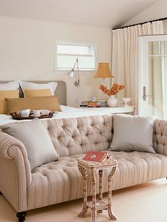 I want a tufted headboard bed frame with a couch at the end of the bed. So cozy!
