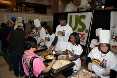 "David West and his wife Lesley host ""Come to Our House"" at Bankers Life Fieldhouse, serving Thanksgiving dinner to more than 700 people from Indy-area shelters."