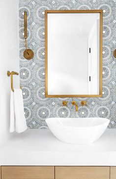 Artistic Tile I We love the classy combination of our Blue Note Circles mosaic, brass fixtures and clean white accents in this pretty powder room designed by Lindye Galloway Interiors.