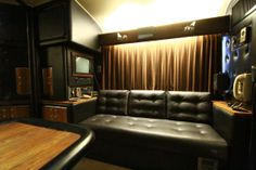 Another seating area for guests with black leather and dark velvet accents on Johnny Cash's bus. See MORE celeb motor homes>> http://www.greatamericancountry.com/shows/celebrity-motor-homes?soc=pinterest