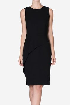 Raven Crepe Elegance Chemise. Asymmetric peplum detailing creates a modern shape on this classic LBD taking it from day-to-night with ease. Play with texture pairing with the Faux Croc Coat.