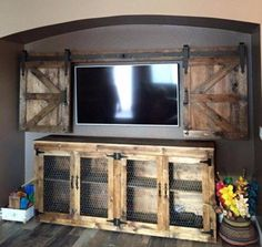 How fun to build a sliding barn wood door to cover your flatscreen TV. An idea