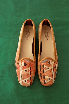 For her Loafers: Each pair of these cozy loafers by Artemis Design Co. is crafted from vintage Turkish kilim wool rugs sourced by designer Milicent Armstrong, who stocks an array of both neutral and brightly colored motifs that add a pop of pattern to any ensemble.