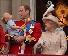 The inquisitive boy looked up at the sky as his beaming father and great-grandmother watch...