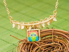 Branch of Gold Leaves Necklace, an inspirational jewelry piece from Artbeads.com, featuring a fun decoupage owl bead.