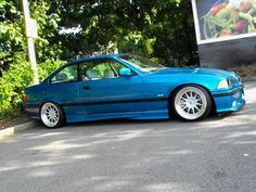 Atlantisblau BMW e36 coupe on cult classic OZ Hartge design C wheels