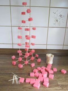 Fun Christmas Games for Your Holiday Parties #christmasgamesforfamily Building game using skewers and foam blocks