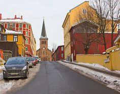 Street in Kampen, Oslo, Norway with Kampen Church in the back
