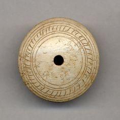 Ivory whorl. Cyprus, 1340 - 1050 BCE. British Museum number 1897,0401.1363