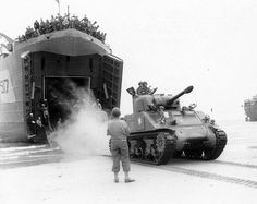 A French Army Sherman tank landed on a Normandy beach from LST-517 2 August 1944.