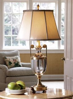 traditional room decor with solid crystal table lamp on the marble top table; crystal lamp with classic urn design features cast brass scrolled arms; decorating idea; luxury home lighting