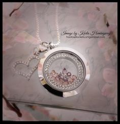 Origami Owl Spring 2015 - crystal window frame, silver twist locket face & base with #vintage rose stardust crystals https://aidanazario.origamiowl.com/
