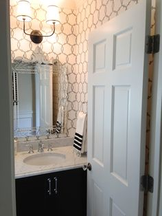 Silver gray powder room - with graphic wallpaper and Venetian mirror