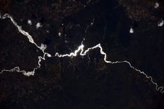 Sun glint on one of a thousand rivers in the heart of #Africa, this one in #Angola.