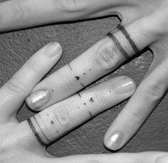 Tiny finger tattoo