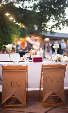 Newlyweds can enjoy a playful seatback arrangement that designates a spot for the bride and groom at the head of the table. The whimsical Mr. & Mrs. chair backs are a fun way to add a giggle or two to your spring backyard wedding. Have the time of your life and your friends won't even know you were planning on a budget! You can use craft paper or any durable canvas of your choice.