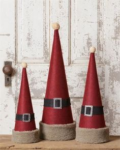 Santa Hat Cone Decor, Set of the cone from Dollar Tree, Red wrapping paper, fur ribbon, and black ribbon.rustic home decor canton ohioChristmas Movies At The Alabama Theater. Cone Trees, Cone Christmas Trees, Christmas Colors, Rustic Christmas, Vintage Christmas, Christmas Holidays, Yarn Trees, Christmas Party Games, Outdoor Christmas Decorations