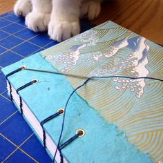 I have a pretty good studio assistant, but sometimes she tries to eat my bookbinding materials... Handmade journal by Ruth Bleakley