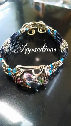 "Apparitions ""Brass Romance"" Cuff Bracelet.  To order, call 252-217-8221"