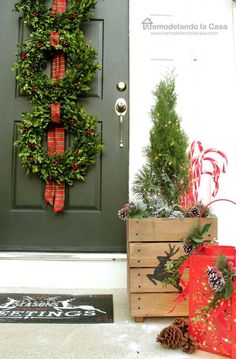 Front porch with boxwood wreath trio - Beautiful Christmas Home Tour