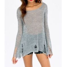 Grey Distressed Sweater Grey Distressed Sweater. LOVE this, worn a couple times & received compliments a several times in a day. Distressed sleeves & bottom hem. This sweater just falls nicely on top of a tiny tank. Tobi Sweaters