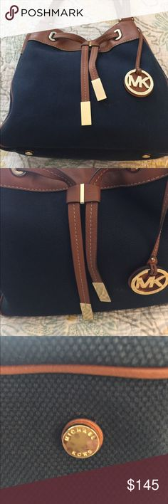 Michael Kors Purse Michael Kors Brooklyn Purse. Navy cloth material with brown leather trim. Lightly used. Beautiful Large classic looking Purse perfect for fall. In great condition. Michael Kors Bags