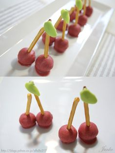 Cherry-shaped Truffles made with strawberry chocolate, Pretz sticks, and green chocolate