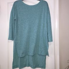 NWT's Hi-Lo top. 52% linen &48% polyester NWT's super cute & comfortable Hi-Lo top. 52% linen & 48% polyester. Soft bluish green in color with hints of white Tops