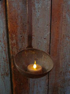 Primitive Old Hearth Iron Ladle...with  grubby beeswax flicker candle.