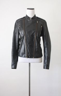 vintage leather motorcycle jacket . Wore my brothers leather jacket the other day. I felt like a rebel. I now need to own a leather jacket.