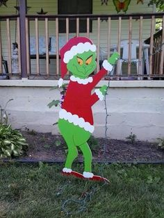 grinch_christmas_standing_grinch_stealing_lights_outdoor_wood_yard_art_dbf5e7b2.jpg (375×500)