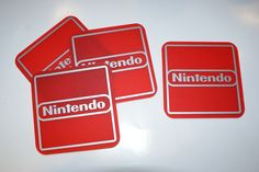 NINTENDO set of 4 Square Coasters ..Matt Red Perspex with Matt Silver Graphics...£14.95 + Delivery... see www.mojo-shop.co.uk for more details