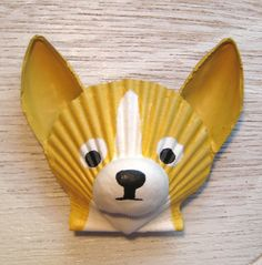 Gold and white chihuahua magnet. Seashell chihuahua magnet. Beach, nautical cape cod dog art. $15.00