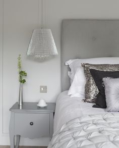glamour  luxury in the bedroom of the honeymoon cottage at Ever After decorated in Farrow  Ball Dimpse and Palladian Grey with  silvers, greys, metallics, sequins  100% linen headboard and bedlinen Photography:  Marc Wilson www.lowergrenofen.co.uk