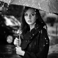 Girl with stunning eyes caught in the rain