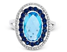 Since topaz is one of the two November birthstones, here is another option for our November ladies. This 14k white gold and black rhodium split-shank ring by Zeghani, with a 4.02 ct. oval-shape blue topaz center set in a halo of 0.73 cts. t.w. round sapphires and another outside border of 0.15 cts. t.w. round diamonds is definitely a great choice for any fan of elegant gemstone rings. www.diamonds.pro