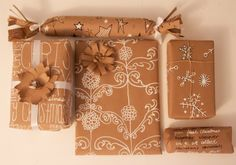 the winthrop chronicles: customized {creative} wrapping paper... white out pen on craft paper - genius!!!