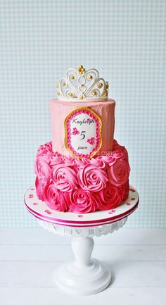 Pink roses and a tiara - I made this cake for a girl who doesn't like fondant. The buttercream rosettes are made of white chocolate buttercream. Inside the cake are three layers of spongecake that are in different shades of pink. It is filled with vanilla cream and strawberry cream.