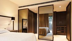 Spacious bedroom due to open dressing room; Patricia Stewart Design