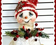 Youll want to make plenty of these fun Holiday whimsys for bazaars, gifts or for yourself! They can hang on the wall/tree or can be used in whatever way you dream up. This is an easy pattern to put together and includes step by step detailed instructions on sewing, painting and finishing techniques. The snowman is 13 1/2 tall and the ginger is 10 tall. I have a tutorial on my blog that shows how I finish this gingerbread man to looked baked and good enough to eat! The information is...