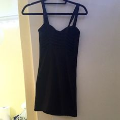 Brandy Melville black bodycon dress Tight black mini dress with cool back cutouts, very flattering Brandy Melville Dresses Mini