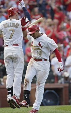 4-14-12 Jon Jay celebrates with Matt Holliday after hitting a solo home run
