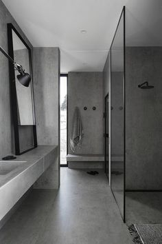 COCOON grey bathroom bycocoon.com | bathroom design inspiration | grey | high end stainless steel shower sets | modern design products for bathroom and kitchen | renovations | villa design | hotel design | Dutch Designer Brand COCOON | Studio Griffiths