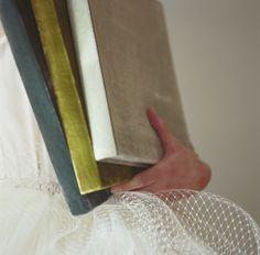 ohhh!! lovely velvet and silk wrapped photo albumsfrom Velvet Raptor