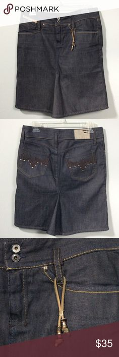 """Diesel Dark Wash Denim Skirt Size 28 Super cute denim skirt with a slight flare. The skirt has cute details: leather beaded tassel on belt loop and brad & stitching embellished pockets. Waist measures 16"""" across and the length is 20"""". Diesel Skirts"""