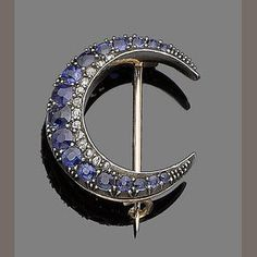 Bonhams 1793 : A sapphire and diamond crescent brooch