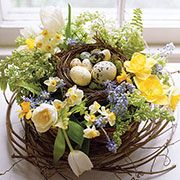Wreath of flowers with egg nest