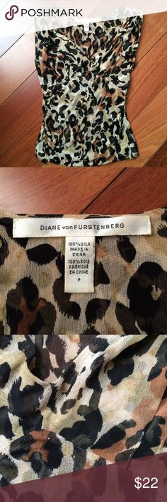 Diane Von Furstenberg Silk V Neck Sleeveless Thin stretchy v neck with slight ruching at V. Size P is their version of XS. Gently used no flaws or damage Diane von Furstenberg Tops Blouses